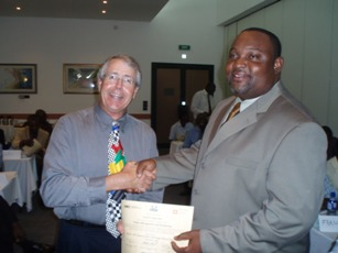 Ghana Builder Getting His Certificate
